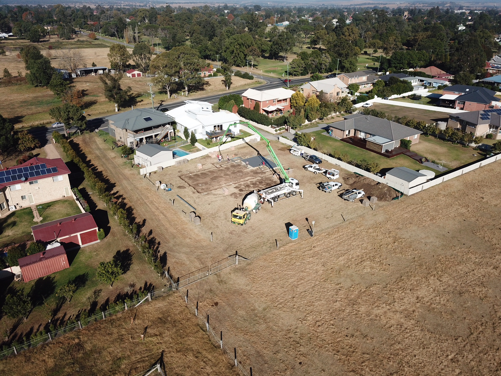 Aerial Shot Of Concrete And Pump For Footings