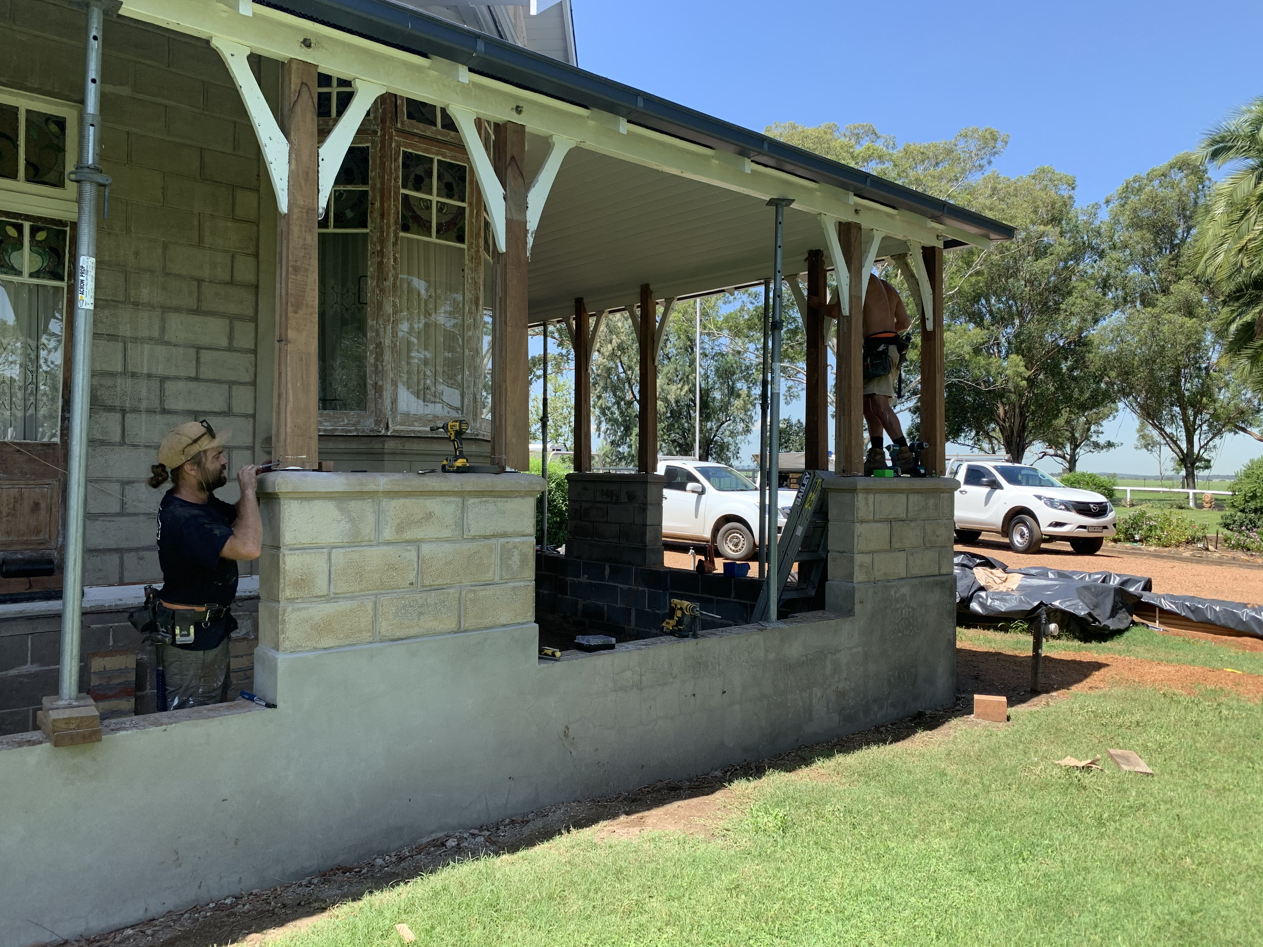 Restoration of stone verandah walls and posts on an old homestead
